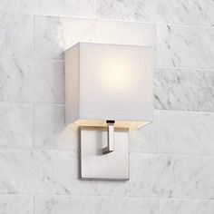 Add contemporary good looks to a hallway, bedroom or bath with this George Kovacs wall sconce.