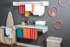 Declutter your laundry room with this dual-purpose drying rack. It has long bars where you can hang clothes to dry, plus an optional hinged table that provides a perfect place for folding and sorting clothes.