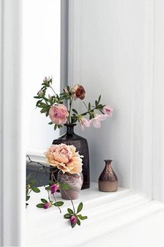 Beautiful flowers in beautiful vases.