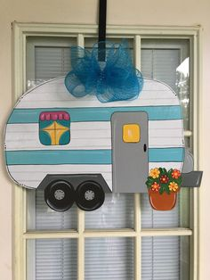 Nothing says Summer than a RV hanger. Use on your front door or when you go camping. It was designed, cut and painted by me. It is made from 1/4 inch light weight wood so it will easily hang from a wreath hanger or a suction cup. IT measures 23.5 by 19 including now. I would be happy to personalize it on the door or on the camper itself. If you would like it personalized please tell me if you want it on the DOOR or RV itself. Long names will need to be written on the RV. If you prefe...