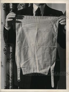 1940 Press Photo A Pinless Diaper in A Mans Hands | eBay.   I have the other photo of this diaper but $30 is to rich for my blood!