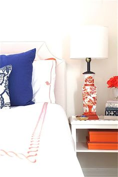 BEDROOM BY ROSA BELTRAN DESIGN LOS ANGELES PROJECT REVEAL: COLONIAL HOUSE TOUR PART 1 COBALT ORANGE CORAL BEDROOM COLOR PALETTE SCHEME HERMES BOXES BOX CHINOISERIE LAMP BIRDS NAVY ROYAL BLUE EMBROIDERED HOTEL LINENS DUVET SHEETS SERENA & LILY GOBI PENGUIN CLASSICS BICKFORD BOOKS JACOBEAN FLORAL ASIAN ORIENTAL SCALLOPED NIGHTSTAND FRENCH DOORS IVORY LINEN UPHOLSTERED HEADBOARD CREAM WHITE OFF WHITE NEUTRAL ROSES STYLING VIGNETTE