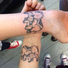 Mother and Daughter matching tattoos. Mom and baby elephants.