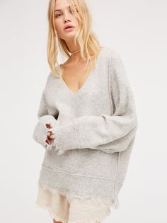 Irresistible V-Neck Sweater | In an oversized silhouette this cozy pullover sweater is featuring fringe trim on the hem and sleeve cuffs. V-neckline for a casual fit.