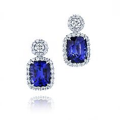 This pair of 18ct white gold earrings are set with cushion cut sapphires and round brilliant diamonds.