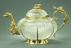 Teapot  Date:      rock crystal ca. 1700, mounts ca. 1720  Culture:      German (Dresden) mounts and Indian (Mughal) crystal  Medium:      Rock crystal and gold  Dimensions:      H. 3-5/8 in. (9.3 cm); Gr. W. 6-1/16 in. (15.5 cm)  Classification:      Metalwork-Silver In Combination