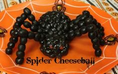 Spider Cheeseball   Holidays- written by momendeavors.com Now THAT is an olive spider! Actually its a cheese ball covered in olives! Ingenious!  You could make it a white tip spider by swapping some of the black olives with maybe some white cocktail onions. Use red cocktail onions and make it a red back! LOL!- Have fun- DIY Mum