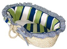 The #Hoohobbers Moses basket made from sophisticated,  designer fabrics. Great care is taken to create linens of the highest quality including doubled ruffles an...