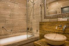 Travertine bathroom in Deluxe room