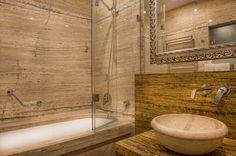 Travertine bathroom in Deluxe room
