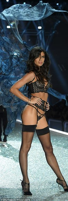 In a wisp: Sara Sampaio pulled off a seductive pose in her lingerie and stockings teamed w...