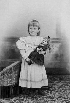 portrait of child with her porcelain doll, paris, c. 1900