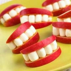 Apple slices with marshmellow teeth held in place with peanut butter.