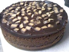 Chocolate and peanut butter cheesecake with chocolate ganache topping and chopped Reeses cups...