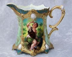 This is an outstanding example of a 1900's unmarked RS Prussia Portrait Creamer.The beautiful Portrait Creamer, which measures 3-78 tall & 4-7/8 long,