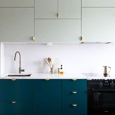 Greens!! Upper fronts in Aerugo Green, some in Blocks pattern. Lower fronts in Bottle Green. Handles are Holy Wafer in brass. Built on the great Ikea Metod cabinet foundation. By: IARK Architects