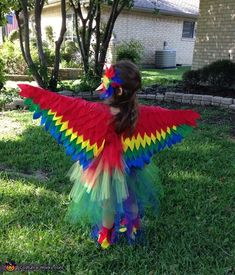 Nicolette: Daughter Madi is wear a red parrot costume. She wanted to be a parrot this year. I made a layered tutu with blue, green, yellow, and red tulle. I bought...