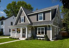 Cape cod style home garage door color matching front for Cape cod house remodel