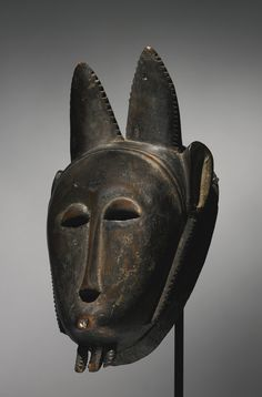 "BAULE MASK, IVORY COAST a blue-bordered paper label on the reverse inscribed in ink: ""1585 / mask""; and nearby painted in white ""B4"". Height..."