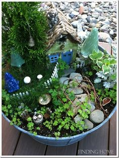 Fairy Garden. I want to make one of these, I don't care how silly it is!