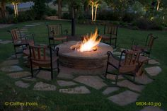 firepit...idea with inset stone into the grass