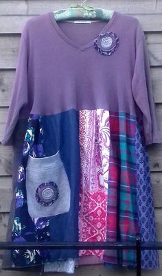 A lovely and unique patchwork dress with stretch cotton top and patchwork skirt in shades of mauve, cute pocket and floral detail at collar. Easy to wear, unique and one of a kind! Measurements: Bust 48 inches will stretch comfortably to 60 inches Waist (at join above natural waist) 54 -