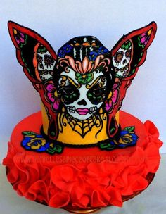 This cake was created for the Sugar Skull Bakers collaboration that was released on Dia de los Muertos. It was inspired by a picture by Illustrated Ink.