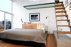 In small spaces — and even in large spaces — nothing does double duty in vertical space like the loft bed! Whether it's maximizing storage space, making the best of a crazy floor plan, or just because it looks cool, building your bed in the air is the way to go. We've found fifteen inspiring beds that involve just a bit of climbing before you crash — come look!