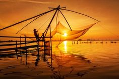 dragging the sun  Photo by Trần Bảo Hòa -- National Geographic Your Shot