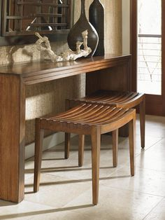 A chic little accent piece that can be used singly or doubled up to add extra seating to any room. The slatted bench was carved from hickory wood and features an earthy, medium brown finish color. Great for use at the end of a bed or with your make-up table and vanity.