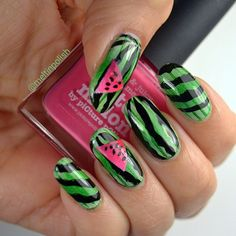Watermelon kinda days!  The base is @colorsbyllarowe Gemini Rising (see previous post for a swatch) and over it thin stripes done with @teismom Nail Vinyls and a bilateral gradient of @essiepolish Chillato. Then the stamping: @essence_cosmetics black stamping polish and @moyou_london Tropical Collection n. 10. For the inside of the fruit: masking tape and a little gradient of @opi_products Alpine Snow, @picturepolish Watermelon and @kikocosmeticsofficial n.281 plus black acrylic.