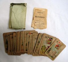 A well-worn set of Lenormand cards, belonging to the Ivanova family. I wonder what they've seen...