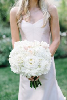 White hydrangeas and roses with a touch of blush roses: http://www.stylemepretty.com/colorado-weddings/aspen/2015/05/26/elegant-all-white-tented-aspen-wedding/   Photography: Kate Holstein - http://www.kateholstein.com/