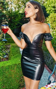 Gorgeous in revealing black leather dress