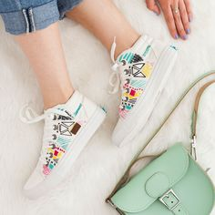 DIY Embroidered Sneakers: All the other kids will be jealous of your stitched-up kicks this spring. Spruce up a boring pair of white sneakers with abstract patterns and geometric embroidery.
