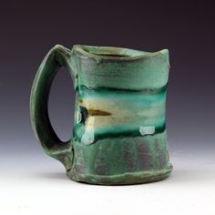 Sculptural stoneware mug, Green matte glaze with soft glass and seashells, Cone 6 oxidation by ShadowMayStudios on Etsy https://www.etsy.com/listing/171933959/sculptural-stoneware-mug-green-matte