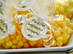 """tag could say """" Thank you for Brightening the World""""    """"Bag of Sunshine""""  Cello bag filled with Lemon Heads and tied up with ribbon.  A simple handout or """"Thank You""""."""