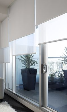 Dollar Curtains & Blinds offers dual roller blinds that allows two fabrics on one window, providing a blockout and a sunscreen fabric. Blinds And Curtains Living Room, Patio Door Blinds, Sliding Door Blinds, House Blinds, Blinds For Windows, Patio Doors, Sliding Glass Door, Living Room Partition Design, Room Partition Designs