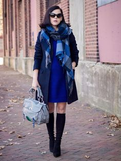 A navy coat and a blue sweater dress are your go-to outfit for lazy days. Black suede knee high boots will instantly smarten up even the laziest of looks.  Shop this look for $193:  http://lookastic.com/women/looks/sunglasses-scarf-sweater-dress-coat-satchel-bag-knee-high-boots/7018  — Black Sunglasses  — Blue Check Scarf  — Blue Sweater Dress  — Navy Coat  — Grey Leather Satchel Bag  — Black Suede Knee High Boots