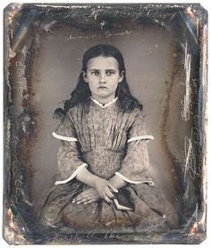 CWFP Skylight Gallery Auction  Sixth plate daguerreotype. anonymous American ca. 1850, showing a girl with loose dark hair and holding a small booklet. Signed repeatedly on the plate. Housed in half case.