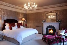 The romantic walls and the chaise bring this room together...Classic Master Bedroom Ideas with Romantic Fireplace