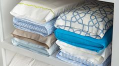 Martha Stewart's weblog recommends that you tuck the sheet set (full, fitted, and other pillowcase) inside one of the pillowcases for that set.  You can then stack your pillowcase sheet sets in the closet according to size—this way you won't lose any pillowcases, everything stays together, and it's easy to find the exact sheet set you're looking for.