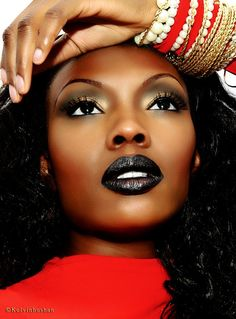 How gorgeous is this look. The metallic eye make up and the black lipstick goes so well with brown skin.