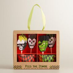 Zombie Punk Cupcake Set at Cost Plus World Market - This affordable kit includes green and orange cupcake liners with frightfully detailed zombie punk toppers that are sure to attract the hungry hordes. >> #WorldMarket Halloween #HalloweenDecor #HalloweenBaking #Cupcakes