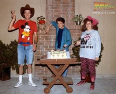 Marc McClure, Michael J. Fox and Wendie Jo Sperber celebrating on the set of Back to the Future Back To The Future Party, Future Love, Science Fiction, Michael J Fox, Bttf, Marty Mcfly, About Time Movie, Cultura Pop, Movie Posters