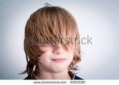 child with long hair and covered eyes - stock photo
