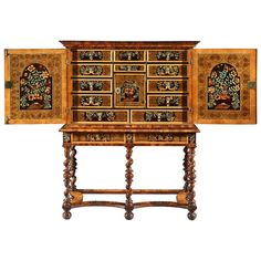 Charles II Oyster Veneered Olivewood and Marquetry Cabinet on Stand | From a unique collection of antique and modern cabinets at https://www.1stdibs.com/furniture/storage-case-pieces/cabinets/