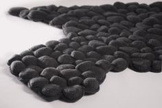 Pebble rug, ideal for massage & relaxation; let it be warm before laying on