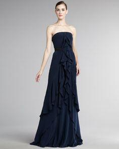 aefc1e33fa The shaped waist and ruffled edges make this gown a wonderful choice for an  elegant black