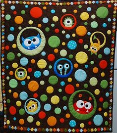 I avoid sewing circles, but this quilt makes me want to sew a lot of them.
